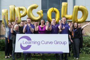 Brenda McLeish Learning Curve CEO celebrates IIP Gold award with employe...